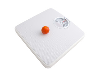 Scale with tomato