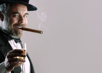 man with glass and cigar