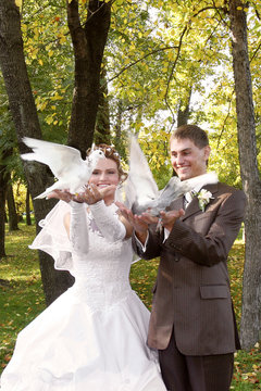 bride and groom with two doves
