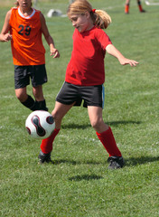 Youth Soccer or Football Player in Action 9