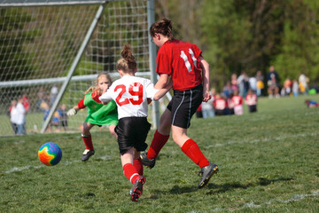 Youth Teen Girls in Action on Soccer Field