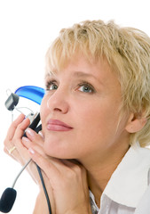 blond woman listening to music with headset