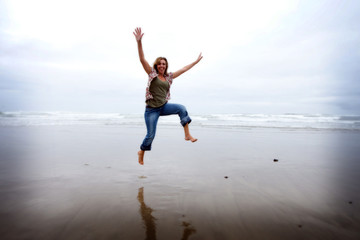 Happy Jumping Woman at the Beach