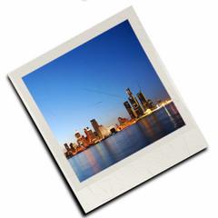 City skyline on polaroid slide (computer generated)