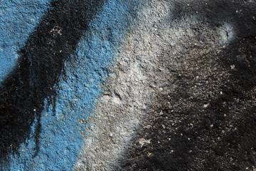 Graffiti on a grainy concrete wall
