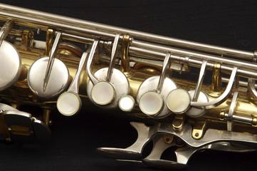 Saxophone against black, alto, upper keys and key mechanism