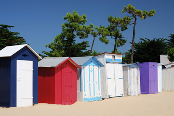 Coloured Beach huts under the sunlight III