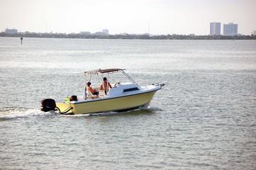 Yellow Outobard Motor Boat