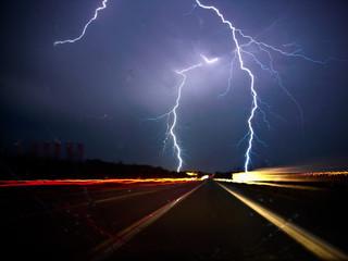Twin lightning bolts strike highway