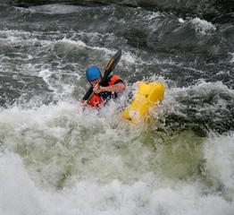 Man Paddling his Kayak on Whitewater Rapids
