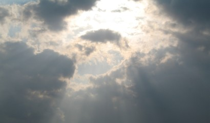 sunlight rays shining through the sky