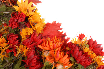 Autumn flowers placed in a pattern to form a border