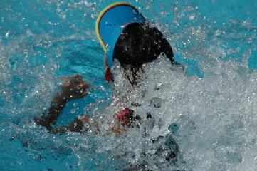 young girl swimming in swimming pool