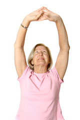 Mature caucasian female doing her exercises,