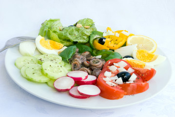 delicatessen anchovy mixed  - vegetable salad with boilrd eggs