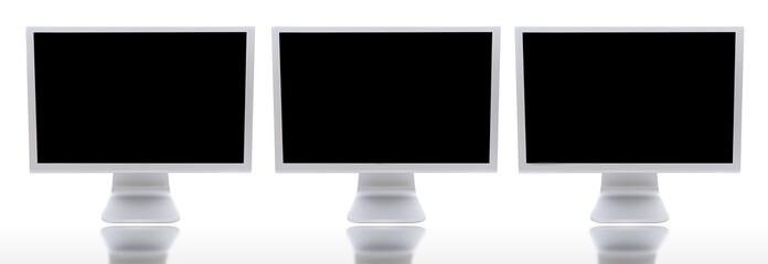 three monitors of computers