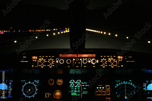 Wall mural aircraft landing at night with runway ahead
