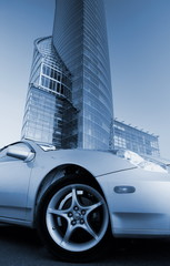 Picture of a modern sport car in front of office building