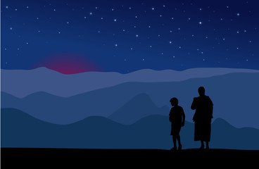 silhouettes of mother and son watching night sky
