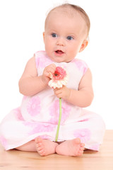 6 months baby girl with flower
