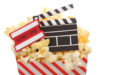 Popcorn, admission ticket and movie clapper