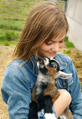 Girl with a goats kid