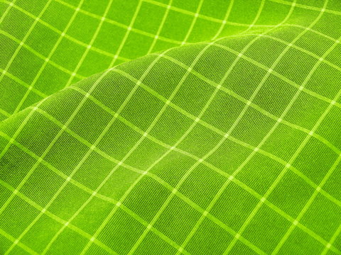 Creased checkered vivid green fabric. Good for background.