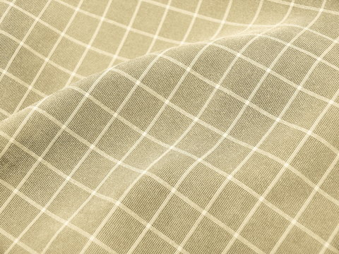 Pleated checkered beige fabric close up. Good for background.