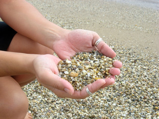 Hands with pebbles
