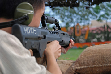 Man testing the machine gun in the army camps