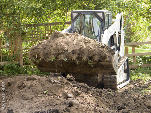 Moving dirt with small tractor