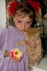 Little girl with her kitten
