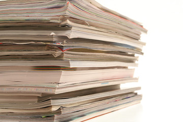 magazines stacked isolated on white