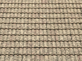 view of a roof with gray tiles structure