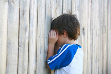 Boy Playing Hide and go Seek