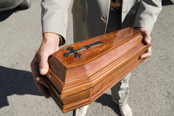 Funeral of the pet. Wooden coffin for dead animal