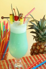 Summer recreational drink with cherry and pineapple
