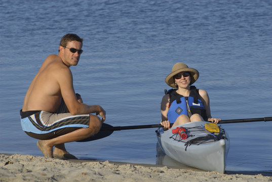 Attractive young female kayaker and her instructor