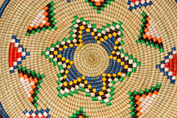 Colorful hand woven African basket