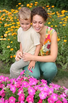 mother with son on flowerbad