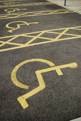 yellow painted disabled parking bay