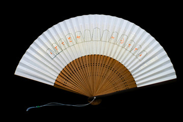 A Japanese fan on black background.