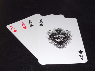 Three Aces in a Card Game on Black Background