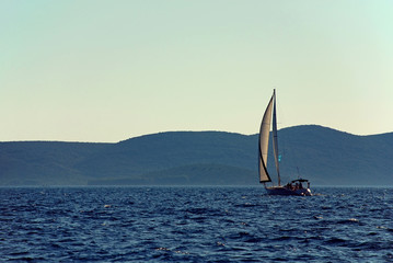 sail boat on the sea with clear blue sky