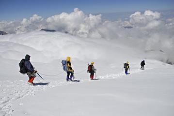 Five  climbers trekking down