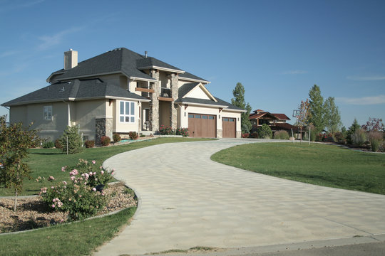 luxury home with large driveway