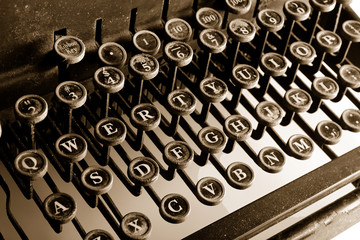 Vintage Typewriter with sepia cast showing most keys