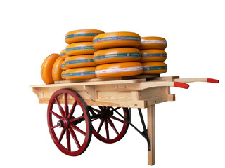 cheese wheels on  cheese cart