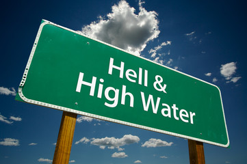 """Hell & High Water"" Road Sign with dramatic blue sky and clouds."