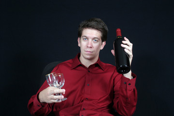 Young man with wine and glasses